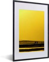Foto in lijst - Zonsondergang bij het Nationaal park Alas Purwo in Oceanië fotolijst zwart met witte passe-partout 40x60 cm - Poster in lijst (Wanddecoratie woonkamer / slaapkamer)