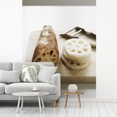 Fotobehang vinyl - De heilige lotus afgebeeld op een snijplank breedte 295 cm x hoogte 400 cm - Foto print op behang (in 7 formaten beschikbaar)