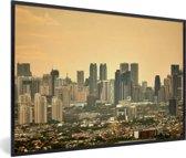 Foto in lijst - Oranje zonsondergang boven Manila fotolijst zwart 60x40 cm - Poster in lijst (Wanddecoratie woonkamer / slaapkamer)