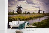 Fotobehang vinyl - De Molens van Kinderdijk in het Europese Nederland breedte 390 cm x hoogte 260 cm - Foto print op behang (in 7 formaten beschikbaar)
