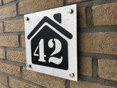 Huisnummer bordjes huis
