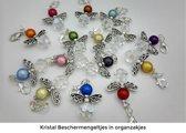 Setje van 16 kristal beschermengeltjes