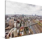 Een bovenaanzicht van de stad Johannesburg in Zuid-Afrika Canvas 120x80 cm - Foto print op Canvas schilderij (Wanddecoratie woonkamer / slaapkamer)