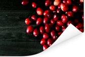 Fel reed met cranberry's Poster 30x20 cm - klein - Foto print op Poster (wanddecoratie woonkamer / slaapkamer)