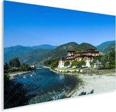 Het Bhutaanse klooster Punakha Dzong met bergen op de achtergrond Plexiglas 180x120 cm - Foto print op Glas (Plexiglas wanddecoratie) XXL / Groot formaat!