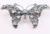 Grote zilveren vlinder broche met blauwe topaas en marcasiet