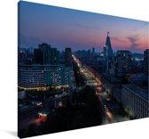 Pyongyang bij een zonsondergang in azië Canvas 120x80 cm - Foto print op Canvas schilderij (Wanddecoratie woonkamer / slaapkamer)