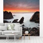 Fotobehang vinyl - Zonsopkomst aan het strand in het natuurpark Sintra-Cascais in Portugal breedte 360 cm x hoogte 360 cm - Foto print op behang (in 7 formaten beschikbaar)