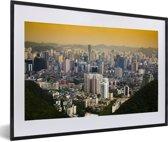 Foto in lijst - Het Chinese Guiyang bij zonsopkomst in Azië fotolijst zwart met witte passe-partout 60x40 cm - Poster in lijst (Wanddecoratie woonkamer / slaapkamer)