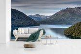Fotobehang vinyl - Kalm meer in het Nationaal park Nahuel Huapi in Argentinië omringt door het groene berglandschap breedte 600 cm x hoogte 360 cm - Foto print op behang (in 7 formaten beschikbaar)