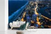 Fotobehang vinyl - Nachtfoto van Gold Coast in Australië breedte 390 cm x hoogte 260 cm - Foto print op behang (in 7 formaten beschikbaar)