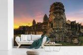 Fotobehang vinyl - Zonsopgang in Angkor Wat in Cambodja breedte 450 cm x hoogte 300 cm - Foto print op behang (in 7 formaten beschikbaar)
