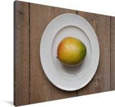 Ovaalvormige mango op een bord Canvas 180x120 cm - Foto print op Canvas schilderij (Wanddecoratie woonkamer / slaapkamer) XXL / Groot formaat!