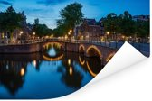 Verlichte Prinsengracht in de avond Poster 30x20 cm - klein - Foto print op Poster (wanddecoratie woonkamer / slaapkamer)
