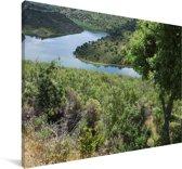 Uitzicht op een knalblauwe rivier in het Spaanse Nationaal park Monfragüe Canvas 90x60 cm - Foto print op Canvas schilderij (Wanddecoratie woonkamer / slaapkamer)