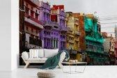 Fotobehang vinyl - Gekleurde huizen in de straten van Lahore breedte 450 cm x hoogte 300 cm - Foto print op behang (in 7 formaten beschikbaar)
