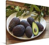 Een bord met avocado's Canvas 180x120 cm - Foto print op Canvas schilderij (Wanddecoratie woonkamer / slaapkamer) XXL / Groot formaat!