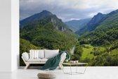 Fotobehang vinyl - Beboste bergketens in het Nationaal park Durmitor in Montenegro breedte 360 cm x hoogte 240 cm - Foto print op behang (in 7 formaten beschikbaar)