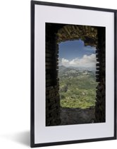 Foto in lijst - Prachtig uitzicht uit een raam van het Citadelle Laferrière fort fotolijst zwart met witte passe-partout 40x60 cm - Poster in lijst (Wanddecoratie woonkamer / slaapkamer)