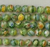 Millefiori glaskralen, groene ronde kralen van 8mm doorsnee. Verkocht per snoer van ca. 52 kralen