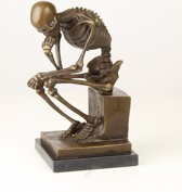 Bronzen beeld van een skelet denker