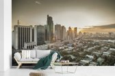Fotobehang vinyl - Zonsopkomst in Manila breedte 560 cm x hoogte 360 cm - Foto print op behang (in 7 formaten beschikbaar)