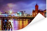 Het hoofdgebouw van de pier in Cardiff met een kleurrijke hemel Poster 90x60 cm - Foto print op Poster (wanddecoratie woonkamer / slaapkamer) / Europese steden Poster