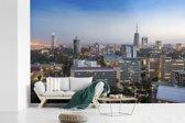 Fotobehang vinyl - Stadsgezicht van het Afrikaanse Nairobi met een blauwe hemel breedte 390 cm x hoogte 260 cm - Foto print op behang (in 7 formaten beschikbaar)