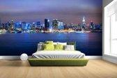 Skyline van New York City bij nacht Fotobehang 380x265