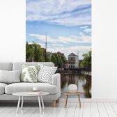 Fotobehang vinyl - Prachtige lucht boven de Nederlandse stad Groningen breedte 240 cm x hoogte 360 cm - Foto print op behang (in 7 formaten beschikbaar)