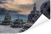 Donkere wolken boven de Borobudur tempel Poster 60x40 cm - Foto print op Poster (wanddecoratie woonkamer / slaapkamer)