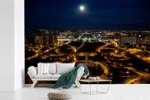 Fotobehang vinyl - De maan schijnt over Brasilia in Brazilië breedte 390 cm x hoogte 260 cm - Foto print op behang (in 7 formaten beschikbaar)