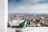 Fotobehang vinyl - Een luchtfoto van Johannesburg op een klaarlichte dag breedte 390 cm x hoogte 260 cm - Foto print op behang (in 7 formaten beschikbaar)
