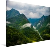 Een dicht wolkenveld boven het Nationaal park Durmitor in Montenegro Canvas 90x60 cm - Foto print op Canvas schilderij (Wanddecoratie woonkamer / slaapkamer)