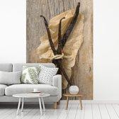 Fotobehang vinyl - Een bundeltje van vanille op papier breedte 145 cm x hoogte 220 cm - Foto print op behang (in 7 formaten beschikbaar)