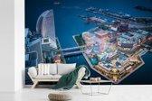 Fotobehang vinyl - Luchtfoto van de baai in de Japanse stad Yokohama breedte 330 cm x hoogte 220 cm - Foto print op behang (in 7 formaten beschikbaar)