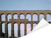 Foto van het aquaduct van Segovia in Europa tijdens de avond Poster 80x60 cm - Foto print op Poster (wanddecoratie woonkamer / slaapkamer)
