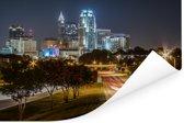 De skyline van Raleigh in de Verenigde Staten tijdens de nacht Poster 120x80 cm - Foto print op Poster (wanddecoratie woonkamer / slaapkamer)