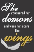 She conquered her demons and wore her scars like wings.: Inspirational motivational quote notebook for women to write in with philosophical quote and