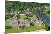 De Tintern Abbey en de rivier naast het dorp Tintern Aluminium 180x120 cm - Foto print op Aluminium (metaal wanddecoratie) XXL / Groot formaat!