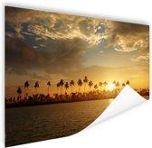Palmbomen bij zonsondergang Poster 120x80 cm - Foto print op Poster (wanddecoratie woonkamer / slaapkamer)