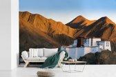 Fotobehang vinyl - Berglandschap rondom het Potalapaleis in Lhasa breedte 420 cm x hoogte 280 cm - Foto print op behang (in 7 formaten beschikbaar)