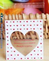 50x Transparante Uitdeelzakjes Hart Design 10 x 10 cm met plakstrip - Cellofaan Plastic Traktatie Kado Zakjes Hartje met tekst - Snoepzakjes - Koekzakjes - Koekje - Cookie Bags Hearts - Love