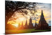 De zon schijnt tussen de tempels door in Ayutthaya Aluminium 180x120 cm - Foto print op Aluminium (metaal wanddecoratie) XXL / Groot formaat!