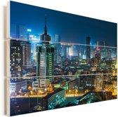 De gebouwen in Dalian in de avond Vurenhout met planken 120x80 cm - Foto print op Hout (Wanddecoratie)
