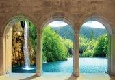 Fotobehang Tropical Waterfall Through The Arches | M - 104cm x 70.5cm | 130g/m2 Vlies