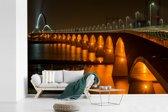 Fotobehang vinyl - Verlichting van de Waalbrug in de Nederlandse stad Nijmegen breedte 450 cm x hoogte 300 cm - Foto print op behang (in 7 formaten beschikbaar)