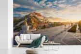 Fotobehang vinyl - Het Potalapaleis met een heldere zonsopgang in China breedte 390 cm x hoogte 260 cm - Foto print op behang (in 7 formaten beschikbaar)