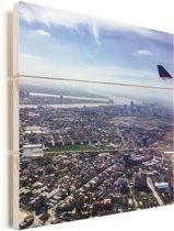 Luchtfoto van het Aziatische Phnom Penh in Cambodja Vurenhout met planken 20x20 cm - klein - Foto print op Hout (Wanddecoratie)