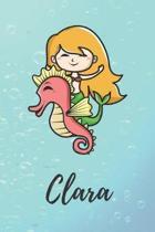 Clara: s��es personalisiertes Meerjungfrauen Schreibheft / Notizbuch / Tagebuch - viele Vornamen verf�gbar - 100 Seiten linie